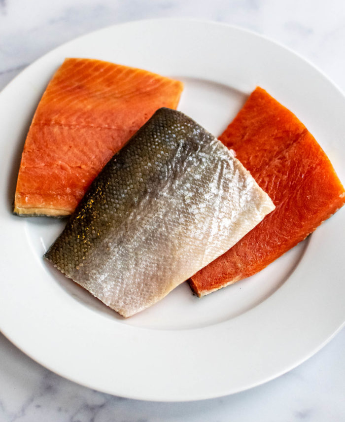 Three pieces of sockeye salmon on a plate